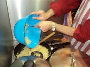 Preparing the filling for pereski - onions, boiled and mashed potato and spices.